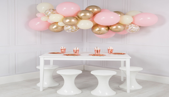 colourful balloon clouds over the dining table