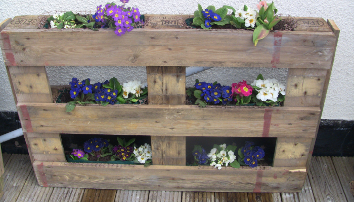 A Flower Shelf made out of wooden Box