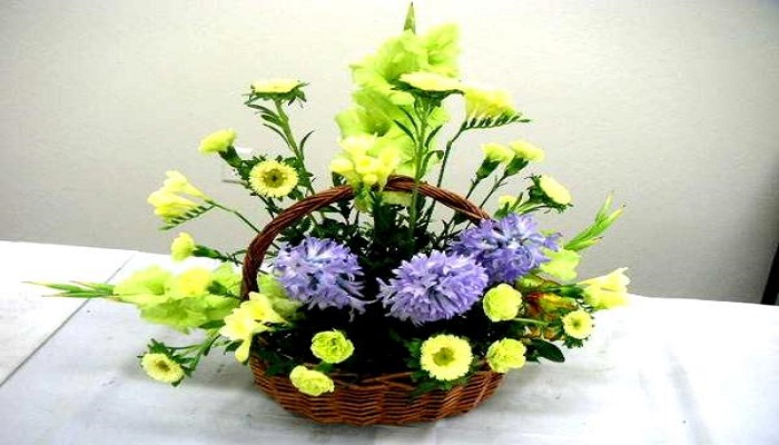 A cute flower basket on a console
