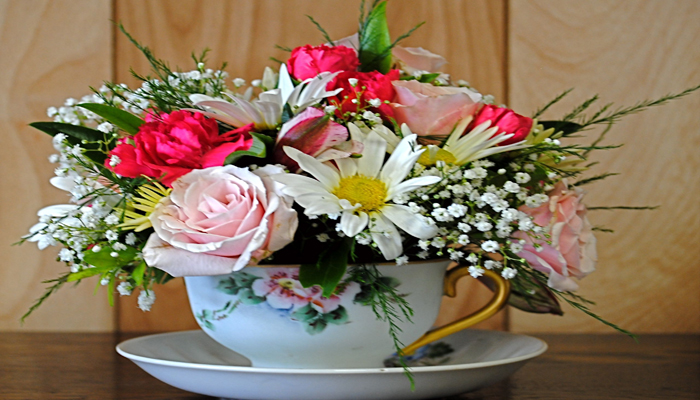 Flowers in a Teacup on Dining Table Decoration